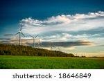 Wind Turbine Farm At Sunset In...