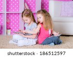 sisters  using modern tablet...   Shutterstock . vector #186512597