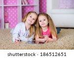 sisters using modern tablet...   Shutterstock . vector #186512651