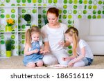 mother and little kids making a ... | Shutterstock . vector #186516119