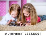 happy sisters using tablet...   Shutterstock . vector #186520094