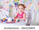 little child drawing using...   Shutterstock . vector #186523805