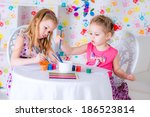 little girls are drawing using... | Shutterstock . vector #186523814