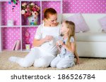 mother and daughter girl... | Shutterstock . vector #186526784
