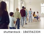 Small photo of Diverse people lining up waiting for their turn to get shots at the hospital vaccination center. Young men and women, senior citizens and kids standing in queue for antiviral Covid-19 or flu vaccine
