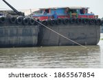 A Boat Transporting Sand In The ...
