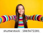 Small photo of Photo of little girl take selfie blink close eye wear striped shirt isolated yellow color background