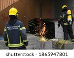 Small photo of Firefighters trying to cut trough venthole with grinder to get the smoke out of people's apartments. Translation: ''Firefighters Rescuers''