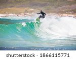 Male Surfer Riding Over The...