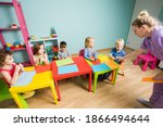the tutor teaches kids how to... | Shutterstock . vector #1866494644