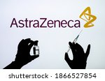 Small photo of Kyiv, Ukraine - December 01, 2020: AstraZeneca Covid-19 vaccine concept. Backlit single shot image of hands.
