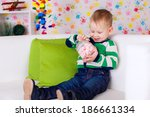 beautiful boy in her room | Shutterstock . vector #186661334