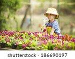 little girl in the garden | Shutterstock . vector #186690197