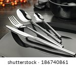 shot of fine cutlery on elegant ...