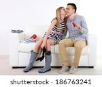 loving couple choose new shoes  ... | Shutterstock . vector #186763241