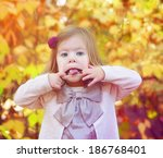 young girl sticking out her... | Shutterstock . vector #186768401