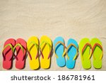 Four Pairs Of Beach Sandals On...