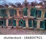 Fishing Crab Traps stacked and loaded ready to be set out at sea to catch crabs and shell fish.