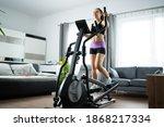 woman training on elliptical... | Shutterstock . vector #1868217334