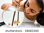 a girl catching fish from a bawl | Shutterstock . vector #18682360