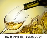 White Wine Being Poured Into A...
