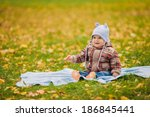 little boy on the yellow leaves ... | Shutterstock . vector #186845441
