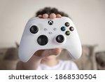 Kid Holding Xbox Series S...