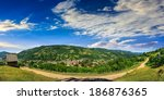 summerlandscape. village on the hillside between the mountain - stock photo