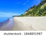 A Wide Sandy Beach Near A High...