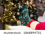 A Woman In Christmas Socks At...