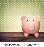 pink piggy bank over green... | Shutterstock . vector #186897914