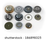 Several machine gears on white background - stock photo