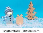 snowman wearing face mask near... | Shutterstock . vector #1869038074