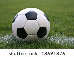 Weathered Black and White Soccer Ball on the Field - stock photo