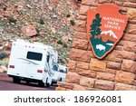 American National Parks RV Journey. National Park Service Shield. Zion National Park Entrance.