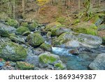 a stream and waterfall in the... | Shutterstock . vector #1869349387