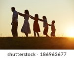 happy family silhouettes on... | Shutterstock . vector #186963677