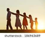 happy family silhouettes on... | Shutterstock . vector #186963689