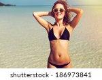 portrait of pretty beautiful... | Shutterstock . vector #186973841