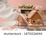 Woman Decorating Gingerbread...