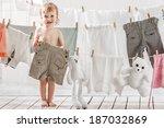 Little Girl Hangs Laundry Or...