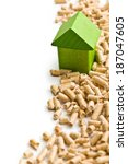 The concept of ecological and economic heating. Wooden pellets. - stock photo