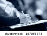 close up of hands holding pens... | Shutterstock . vector #187055975