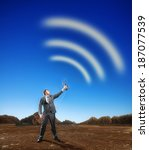 Small photo of Businessman creating airwaves with antenna