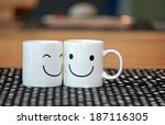 two happy cups on wood table... | Shutterstock . vector #187116305