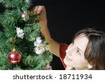 young woman decorate christmas... | Shutterstock . vector #18711934