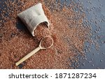 Flax Seeds In Wooden Spoon And...
