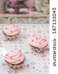 vanilla cupcakes with pink curd ... | Shutterstock . vector #187133045