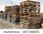 Wooden Pallets Stacked Along A...