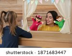 Mother Performing Puppet Show...